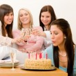 Birthday party - woman blowing candle on cake — Stock Photo #5193427