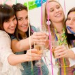 Stock Photo: Birthday party celebration - four womwith confetti have fun
