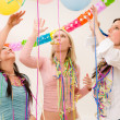 Birthday party celebration - four woman with confetti - Stockfoto