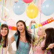 Birthday party celebration - four woman with confetti have fun - Stockfoto
