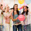 Stock Photo: Birthday party celebration - four womwith confetti