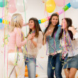 Birthday party celebration - four woman with confetti — Stock Photo