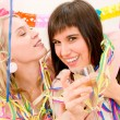 Stock Photo: Birthday party celebration - two womwith confetti have fun