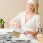 Modern kitchen - happy woman washing dishes — Stock Photo