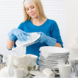 Modern kitchen - happy woman washing dishes — Stock Photo