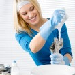 Modern kitchen - happy woman washing dishes - Stock Photo
