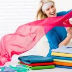 Laundry - woman folding clothes — Stock Photo