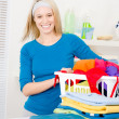 Laundry - woman folding clothes home - Stock Photo