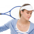 Tennis player - young woman holding racket — Stock Photo #5193733