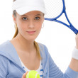 Tennis player - young woman holding racket - Stock Photo