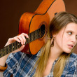 Rock musician - fashion woman holding guitar — Stock Photo