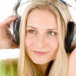 Young woman with headphones listen to music — Stock Photo #5194073