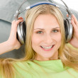Cheerful young woman with headphones — Stock Photo