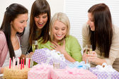 Birthday party - happy woman getting present — Stok fotoğraf
