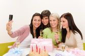 Birthday party - cheerful woman take photo with camera — Stock Photo