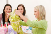 Birthday party - woman unwrap present, surprise — Stock Photo
