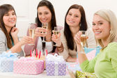 Birthday party - woman drink champagne — Stock Photo