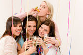Birthday party celebration - four woman with confetti have fun — Stock Photo