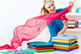 Laundry - woman folding clothes — Stockfoto