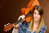 Rock musician - fashion woman holding guitar — Стоковое фото
