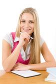 Happy student woman write homework — Stock Photo