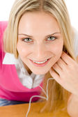 Cheerful student woman listen to music — Stock Photo