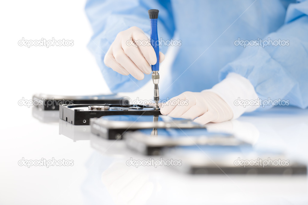 Computer engineer repair hard disc defect, experiment in sterile laboratory — Stock Photo #5193300