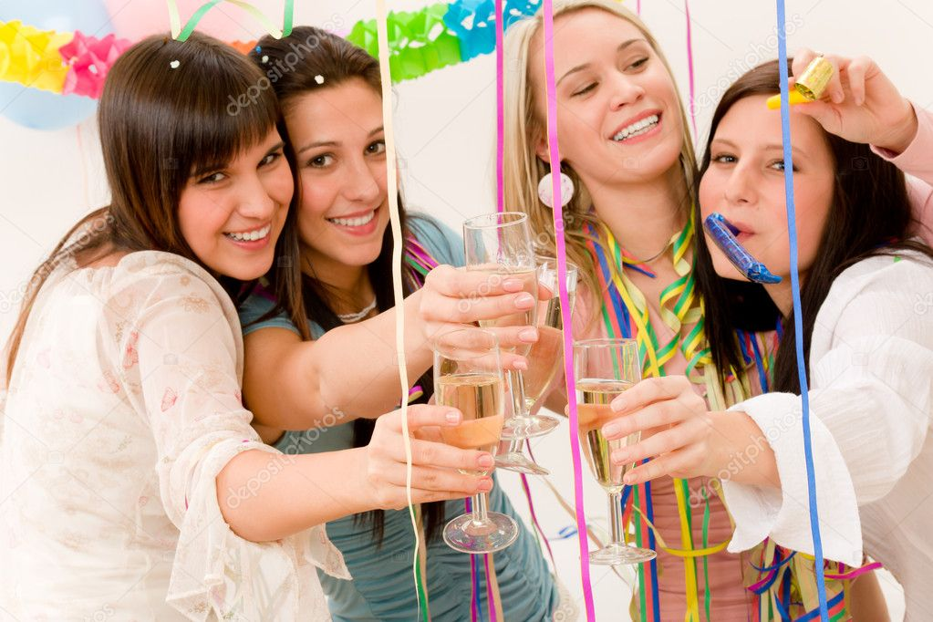 Birthday party celebration - four woman with confetti have fun, focus on glasses  Stock Photo #5193442