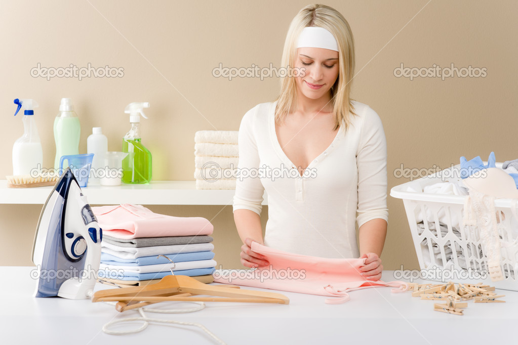 Laundry ironing - woman folding clothes, housework — Stock Photo #5193516