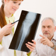 Doctor office - female physician patient x-ray — Stock Photo