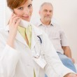 Doctor office - female physician make phone call — Stock Photo
