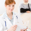 Doctor office - female physician book patient — Stock Photo