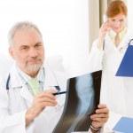 Medical team - senior doctor x-ray in hospital — Stock Photo