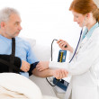 Hospital - doctor check blood pressure patient — Stock Photo