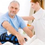 Hospital - female nurse care patient broken leg — Stock Photo #5498737
