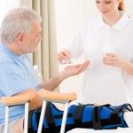 Hospital - female nurse pill patient broken leg — Stock Photo #5498742