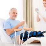 Hospital - female nurse syringe patient broken leg — Stock Photo #5498749
