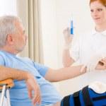 Hospital - female nurse syringe patient broken leg — Stock Photo #5498761
