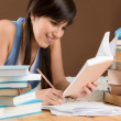 Home study - woman teenager write notes — Stock Photo