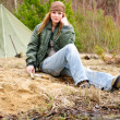 Camping woman tent nature sitting stream - Stock Photo