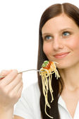 Italian food - healthy woman eat spaghetti sauce — Stock Photo