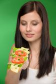 Healthy lifestyle - woman enjoy cheese sandwich — Stock Photo