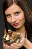 Chocolate - portrait young woman hold candy — Stock Photo