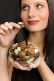 Chocolate - portrait young woman enjoy candy — Stock Photo