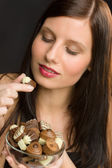 Chocolate - portrait young healthy woman eat candy — Stock Photo