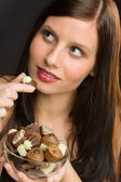 Chocolate - portrait young woman eat candy — Stock Photo