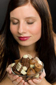 Chocolate - portrait young healthy woman enjoy candy — Stock Photo