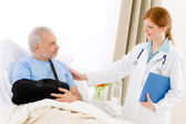 Hospital - female doctor examine senior patient — Stock Photo