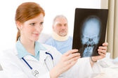 Hospital - female doctor examine patient x-ray — Stock Photo