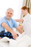 Hospital - female nurse care patient broken leg — Stock Photo